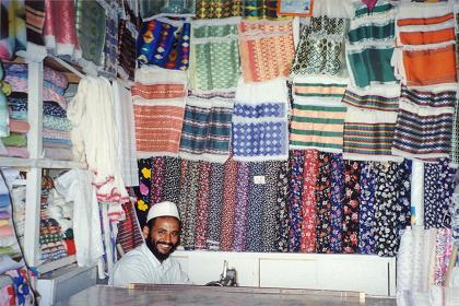 Colorful traditional clothing in a tailors shop in Asmara